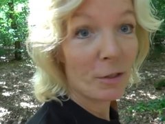 German blonde MILF in stockings gets horny in the forest