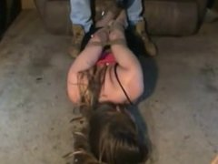 Kidnapped girl gagged and hogtied on floor