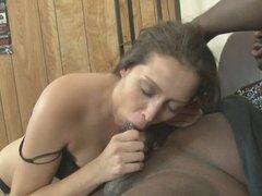 Horny brunette sucking a big black cock dry