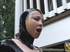 Latex girl tied, wrapped, and hoisted P1