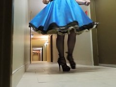 Sissy Ray in Blue Satin Dress in Corridor of Hotel
