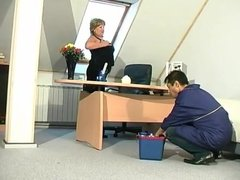 Blonde granny in stockings turns on a young man