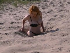 Sexy Mature lady makes an erotic sink in quicksand