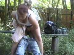 young girl screwing an older guy outside on a bench