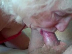 Blonde granny eating a young shaft