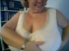 Mature Nancy playing with her boobs on webcam