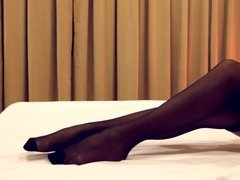 Black pantyhose on the bed