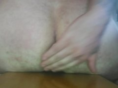 Inserting  butt plug