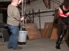 Superheroine escape attemp in weighted strappado