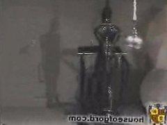 Slave hopping on treadmill in bondage