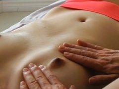 Asian gets breast massage for cleansing (therapeutic ONLY)