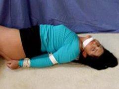 Sexy lady struggling in tight bondage