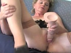 Slut grandma masturbating with a big dildo