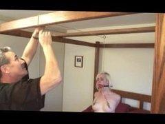Blonde slave bound for tits torture