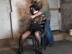 Cuffed and chained to a chair