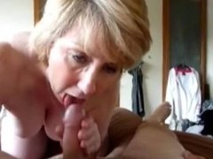 Mature gal drying his balls dry