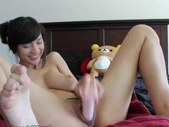 Big titted brunette rides dildo on webcam