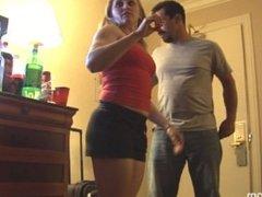 Women take turn lifting man