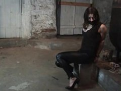 Cuffed and chained in basement