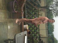Naked and hard wanking outdoors