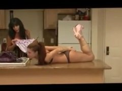 Sexy lady tape hogtied on kitchen counter