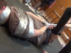 guy duct taped by a woman
