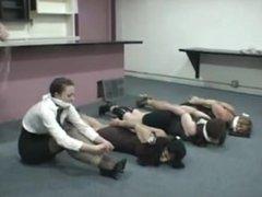 4 women bound on floor