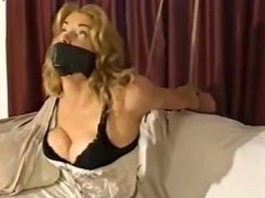 Sexy blonde in strappado bondage on couch