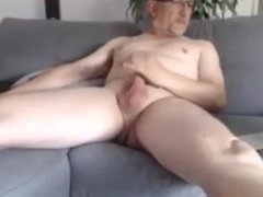 Old guy shooting a huge load hitting his face