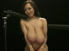 Busty asian smashing her super huge tits