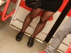 Tight black miniskirt and black sheer pantyhose