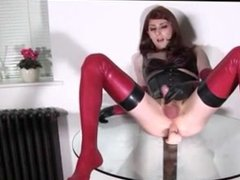 Redhead rides dildo and jerks off on table