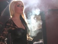 Blonde smoking in heavy makeup