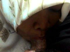 indonesian milf in hijab jilbab giving blowjob
