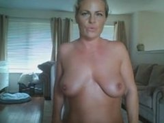 Blond mature plays with her toy and tits