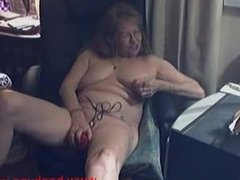 Horny granny uses her dildo to make herself cum
