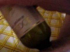 Wife masturbating with wine bottle