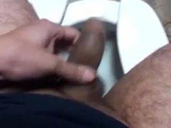 Under stall handjob and blow job swap