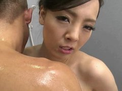 Asian with gigantic tits washing a guy