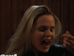 Starving slave girl nibbles at food from her mistress