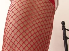 Hot nurse in red stockings shoves a toy in her slit