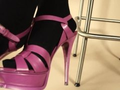Pink stiletto high heels sandals and black stockings