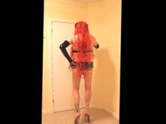 Red haired traanny in stud bra and micro skirt