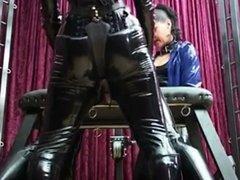 Mistresses spitroast latex Slave with Strapons