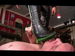 Young Girl in shiny Catsuit & Boots dominate a Man in a Bar