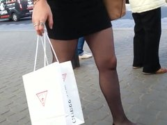 Flats miniskirt and sheer black pantyhose