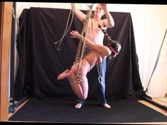 Hanging in rope to orgasm repeatedly