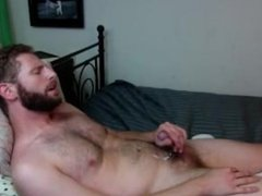Otter cums at the foot of his bed