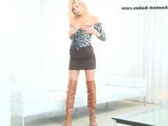 Cassey playing with her pussy wearing tan over the knee boots
