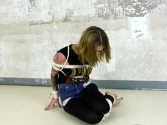 Hot blonde tied up and tape gagged